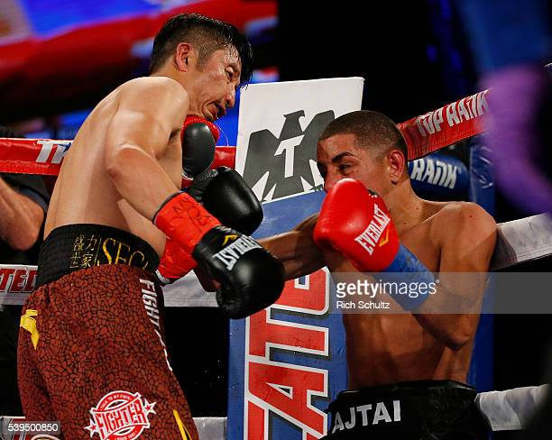Zou Shiming left is hit by a left punch by Jozsef Ajtai in their Flyweight Championship bout on June 11 2016 at the Theater at Madison Square Garden...