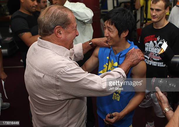 Zou Shiming of China and Bob Arum share a laugh during a work out at Wild Card Boxing Club ahead of Shiming 's six-round bout against Jesus Ortega on...