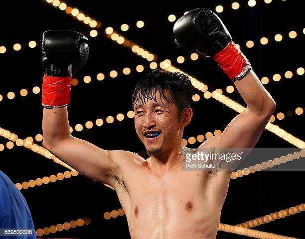 Zou Shiming of China celebrates his unanimous decision over Jozsef Ajtai in their Flyweight Championship bout on June 11 2016 at the Theater at...