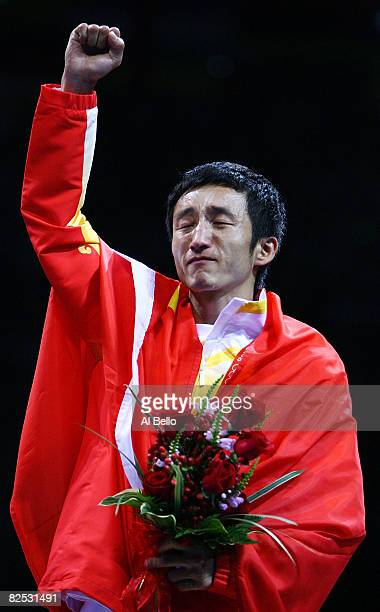 Zou Shiming of China cries as he receives his gold medal after defeating Serdamba Purevdorj of Mongolia during the Men's Light Fly final boxing bout...