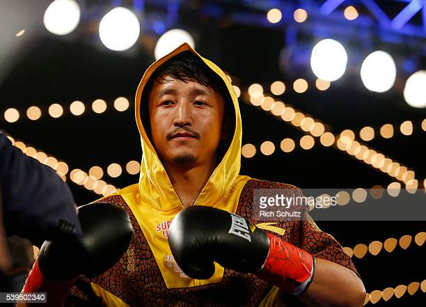 Zou Shiming of China enters the ring for his Flyweight Championship bout against Jozsef Ajtai on June 11 2016 at the Theater at Madison Square Garden...