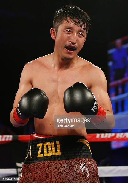 Zou Shiming of China in action against Jozsef Ajtai in their Flyweight Championship bout on June 11 2016 at the Theater at Madison Square Garden in...