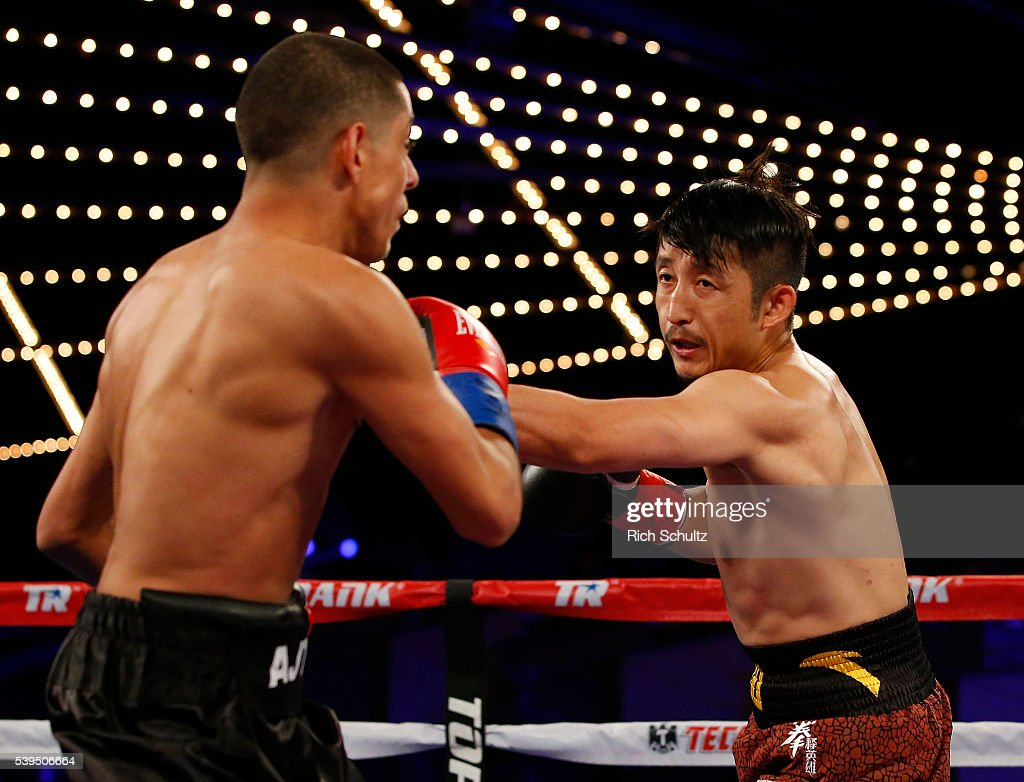 Zou Shiming, right, and Jozsef Ajtai exchange punches in their Flyweight Championship bout on June 11, 2016 at the Theater at Madison Square Garden in New York City. Shiming won by a unanimous decision.