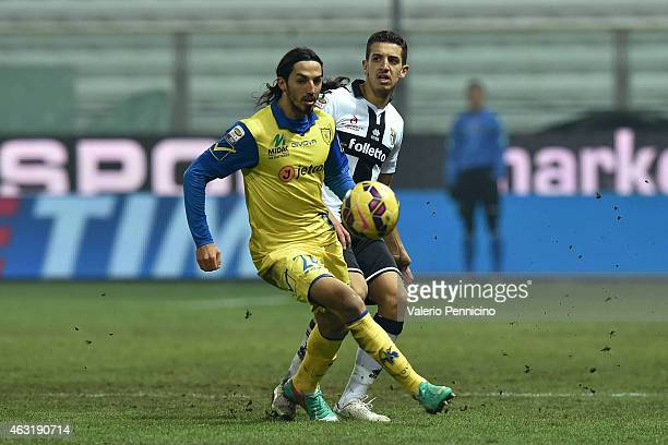 Zouhair Feddal of Parma FC competes with Ezequiel Schelotto of AC Chievo Verona during the Serie A match between Parma FC and AC Chievo Verona at...