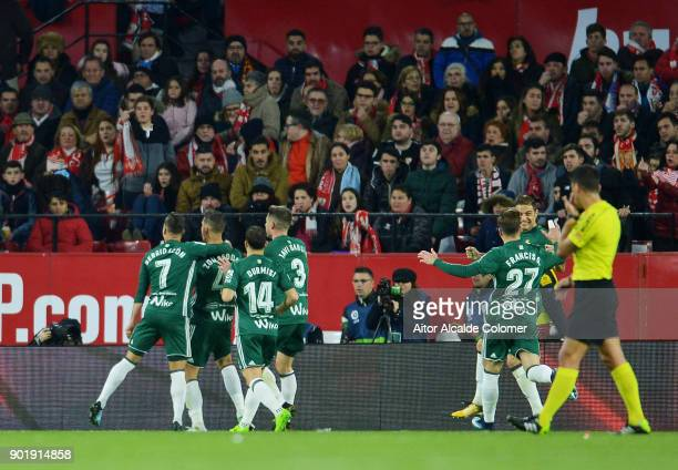 Zouhair Feddal of Real Betis celebrates after scoring his team's second goal during the La Liga match between Sevilla FC and Real Betis Balompie at...