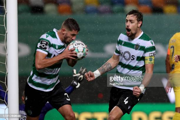 Zouhair Feddal of Sporting CP celebrates with Sebastian Coates after scoring a goal during the Portuguese League football match between Sporting CP...