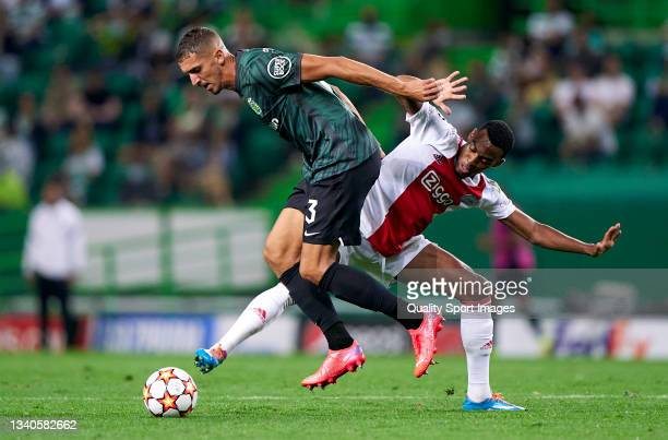 Zouhair Feddal of Sporting CP competes for the ball with Jurrien Timber of AFC Ajax during the UEFA Champions League group C match between Sporting...