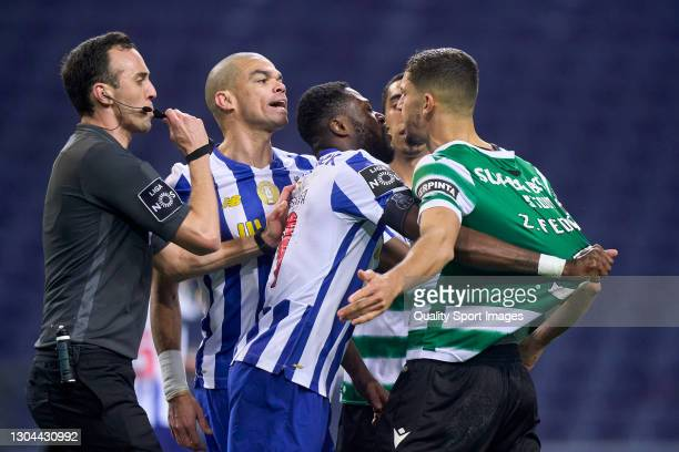 Zouhair Feddal of Sporting CP discuss with Kepler Lima 'Pepe' of FC Porto during the Liga NOS match between FC Porto and Sporting CP at Estadio do...