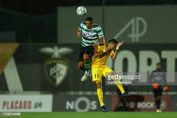Zouhair Feddal of Sporting CP higher that Welinton Junior of Portimonense SC heads the ball during the pre season friendly match between Portimonense...