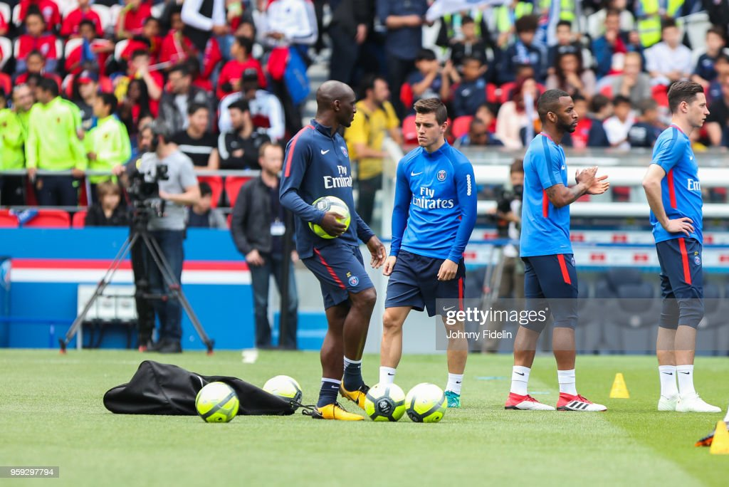 Zoumana Camara assitant coach and Giovani Lo Celso of PSG during the training session of Paris Saint Germain at Parc des Princes on May 16, 2018 in Paris, France.