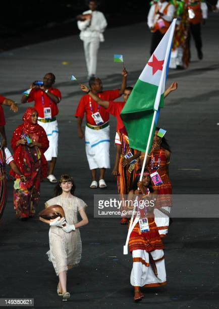 Zourah Ali of the Djibouti Olympic athletics team carries her country's flag during the Opening Ceremony of the London 2012 Olympic Games at the...