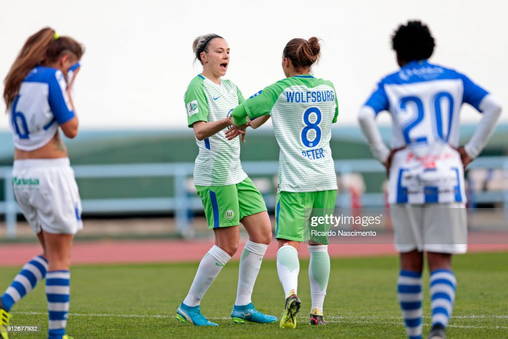 Zsanett Jakabfi (L) and Babett Peter (R) of Wolfsburg celebrate a goal during the Women's friendly match between VfL Wolfsburg and SC Huelva on January 31, 2018 in Vila Real Santo Antonio, Portugal.
