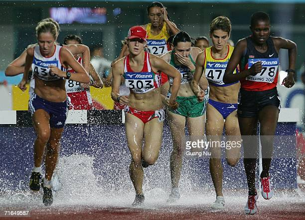 Zsofia Erdelyi of Hungary and Ancuta Bobocel of Romania compete for the women's 3000 metres steeplechase during the 11th World Junior Championships...