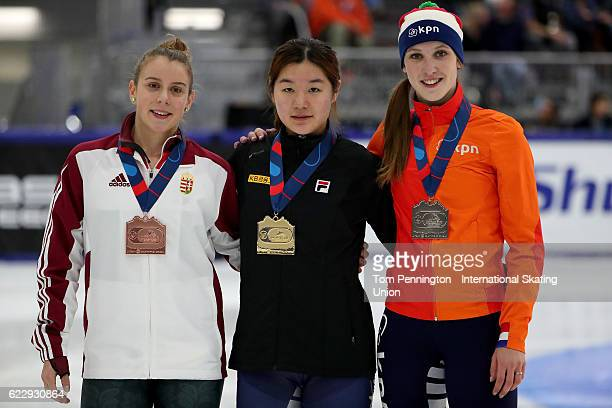 Zsofia Konya of Hungary with the bronze medal Jiyoo Kim of Korea with the gold medal and Suzanne Schulting of the Netherlands with the silver medal...