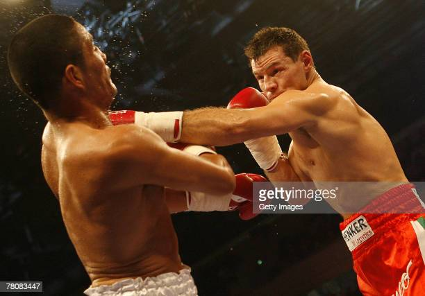 Zsolt Erdei and Tito Mendoza in action during the WBA World Championship Half Heavyweight fight between Zsolt Erdei and Tito Mendoza at the...