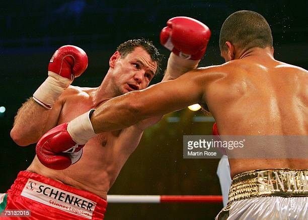Zsolt Erdei of Hungary and Danny Santiago of USA in action during the WBO Light Heavyweight World Championship fight between Zsolt Erdei of Hungary...