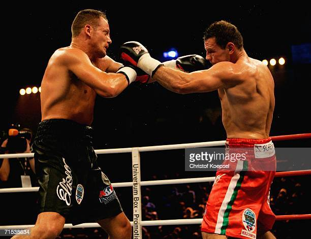 Zsolt Erdei of Hungary boxes Thomas Ulrich of Germany during the WBO Light Heavyweight Title fight at the KoenigPilsener Arena on July 29 2006 in...