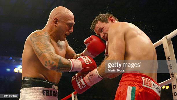 Zsolt Erdei of Hungary exchanges punches with Giacobbe Fragomeni of Italy during the WBC cruiserweight world championship fight during the Universum...