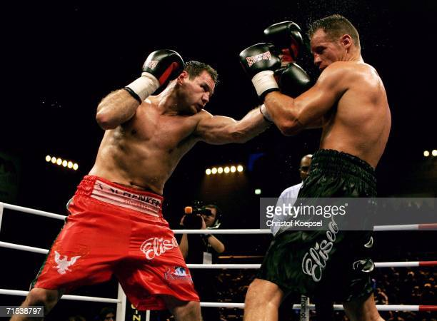 Zsolt Erdei of Hungary fights against Thomas Ulrich of Germany during the WBO Light Heavyweight Title fight at the KoenigPilsener Arena on July 29...