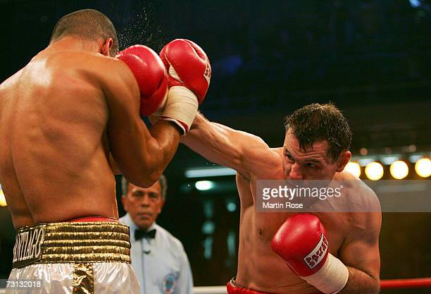 Zsolt Erdei of Hungary hits Danny Santiago of USA during the WBO Light Heavyweight World Championship fight between Zsolt Erdei of Hungary and Danny...
