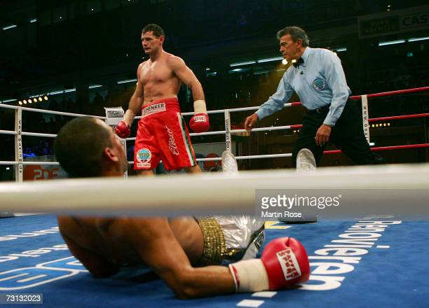 Zsolt Erdei of Hungary knocks Danny Santiago of USA out during the WBO Light Heavyweight World Championship fight between Zsolt Erdei of Hungary and...