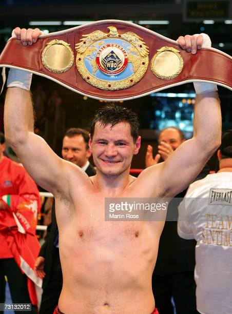 Zsolt Erdei of Hungary poses with the belt after the WBO Light Heavyweight World Championship fight between Zsolt Erdei of Hungary and Danny Santiago...