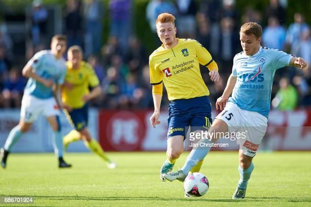Zsolt Kalmár of Brondby IF and Troels Klove of SonderjyskE compete for the ball during the Danish Alka Superliga match between SonderjyskE and...