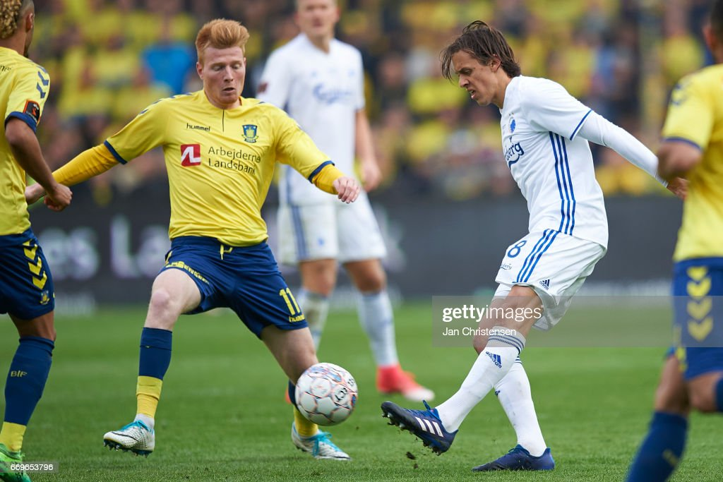 Zsolt Kalmár of Brondby IF and Uros Matic of FC Copenhagen compete for the ball during the Danish Alka Superliga match between Brondby IF and FC Midtjylland at Brondby Stadion on April 17, 2017 in Brondby, Denmark.