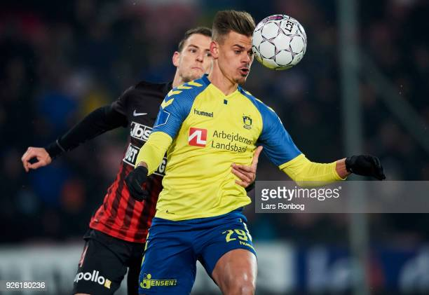 Zsolt Korcsmar of FC Midtjylland and Jan Kliment of Brondby IF compete for the ball during the Danish Alka Superliga match between FC Midtjylland and...