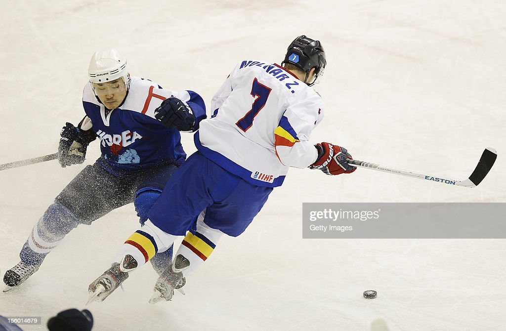 Zsolt Molnar (R) #7 of Romania skates during the Ice Hockey Sochi Olympic Pre-Qualification Group J match between South Korea and Romania at Nikko Kirifuri Ice Arena on November 11, 2012 in Nikko, Tochigi, Japan. South Korea won 2-0.