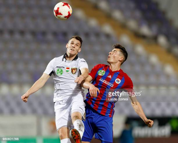 Zsombor Berecz of Vasas FC battles for the ball in the air with Daniel Gazdag of Budapest Honved during the Hungarian OTP Bank Liga match between...
