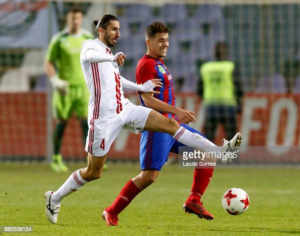 Zsombor Berecz of Vasas FC competes for the ball with Ioan Filip of DVSC during the Hungarian OTP Bank Liga match between Vasas FC and DVSC at Ferenc...