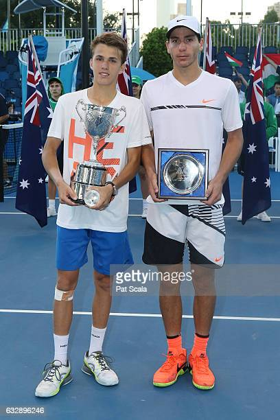 Zsombor Piros of Hungary and Yshai Oliel of Israel pose with their trophies after the Junior Boys Singles Final during the Australian Open 2017...