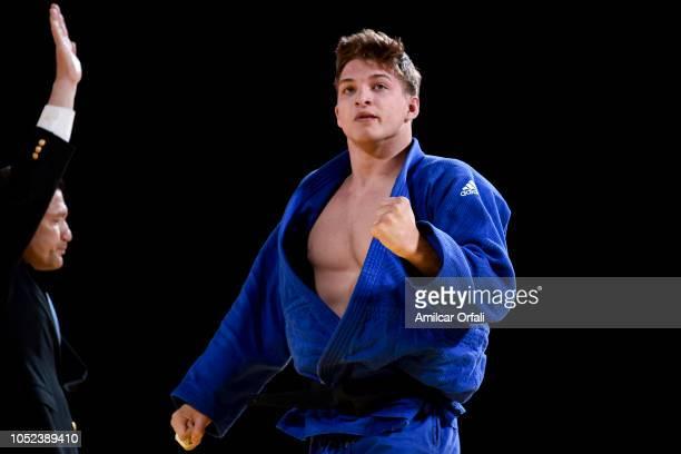 Zsombor Veg of Hungary celebrates after winning the bronze medal against Rok Pogorevc of Slovakia in the Men's 100 kg Contest for Bronze Medal B...