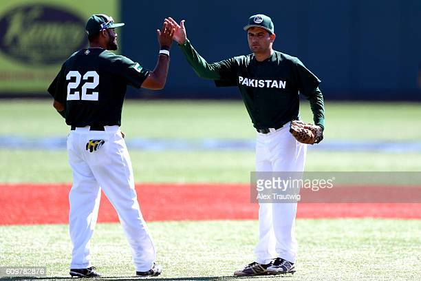 Zubair Nawaz and Inayat Ullah Khan of Team Pakistan celebrate after an out during Game 1 of the 2016 World Baseball Classic Qualifier at MCU Park on...