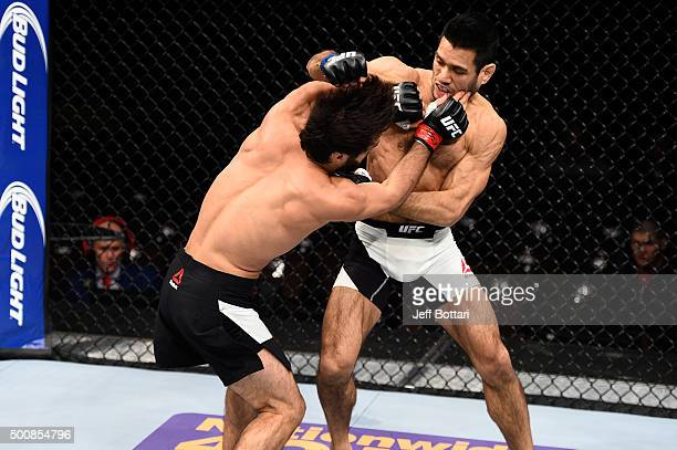 Zubaira Tukhugov and Phillipe Nover exchange punches in their featherweight bout during the UFC Fight Night event at The Chelsea at the Cosmopolitan...