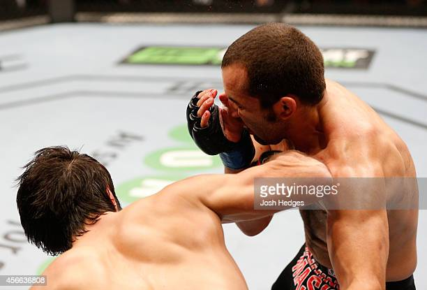 Zubaira Tukhugov of Russia punches Ernest Chavez in their featherweight bout at the Ericsson Globe Arena on October 4 2014 in Stockholm Sweden