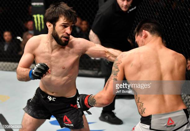 Zubaira Tukhugov of Russia punches Kevin Aguilar in their featherweight bout during the UFC Fight Night event at Spark Arena on February 23 2020 in...