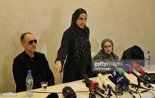 Zubeidat Tsarnaeva the mother of suspected Boston bombers Tamerlan and Dzhokhar Tsarnayev speaks to reporters while the father Anzor Tsarnaev and...