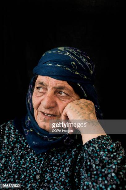 Zubeyda Ali who fled Kobani Syria with her whole family including ten married children and 25 grandchildren was tattooed at the age of 13 She has a...