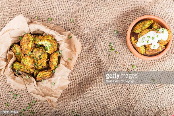 zucchini balls - fritter stock photos and pictures