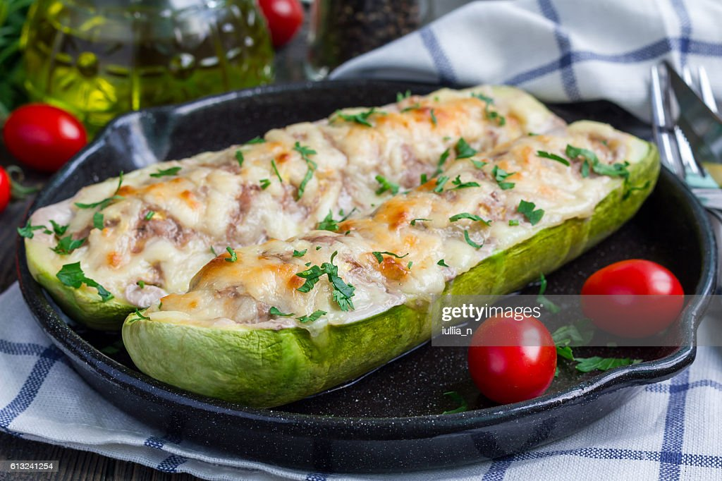 Zucchini boats stuffed with ground meet and topped with cheese : Stock Photo