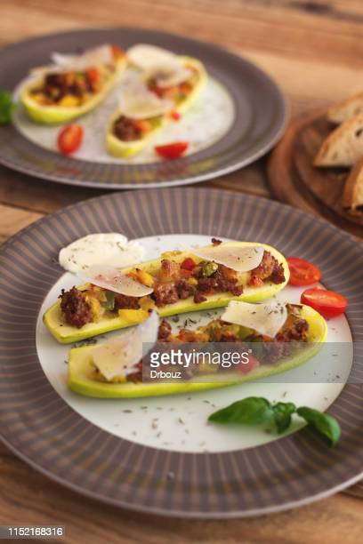 zucchini boats stuffed with minced meat and veggies - marrow squash stock pictures, royalty-free photos & images