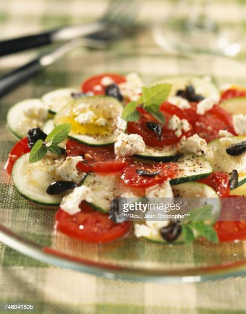 Zucchini carpaccio with feta and tomatoes