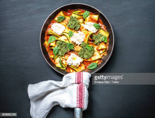 zucchini skillet lasagne with black background - lasagna stock pictures, royalty-free photos & images