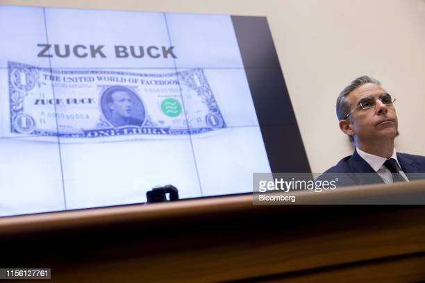 A Zuck Buck is displayed on a monitor as David Marcus head of blockchain with Facebook Inc right is questioned by Representative Brad Sherman a...