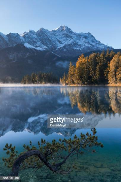 zugspitze and eibsee panorama - garmisch-partenkirchen, bavaria - garmisch partenkirchen stock pictures, royalty-free photos & images
