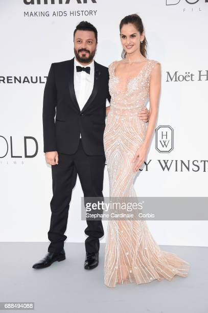 Zuhair Murad and Izabel Goulart arrive at the amfAR Gala Cannes 2017 at Hotel du CapEdenRoc on May 25 2017 in Cap d'Antibes France