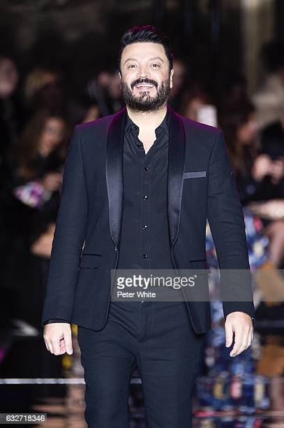 Zuhair Murad walks the runway after the Zuhair Murad Spring Summer 2017 show as part of Paris Fashion Week on January 25 2017 in Paris France