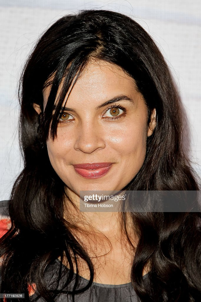Zuleikha Robinson attends the artist's reception for Billy Zane's solo art exhibition 'Seize The Day Bed' on August 21, 2013 in Los Angeles, California.